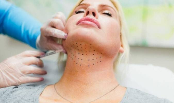 Blonde lady getting her double-chin removed without surgery