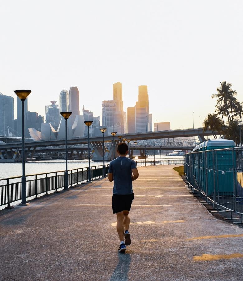 A man running under sun